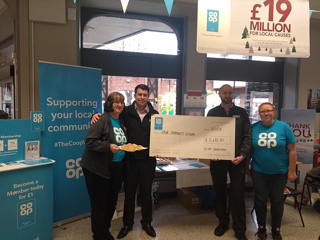 Waders Pool receiving cheque from Co-op